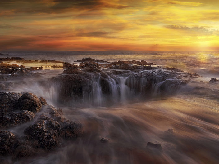 Thors Well at Cooks Chasm by Cape Perpetua on the Oregon Coast during a fiery unset